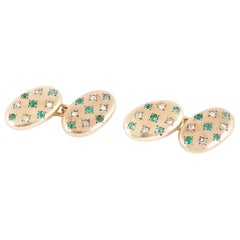 Cufflinks in 18 Karat Gold set with Emeralds and Diamonds, French circa 1900.