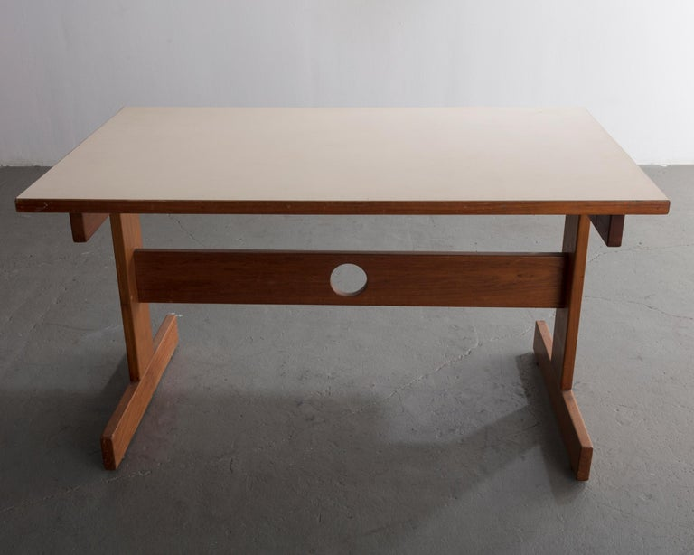 Dining table from the Cuiabá series in caviona wood with formica top. Designed by Sergio Rodrigues, Brazil, 1985.