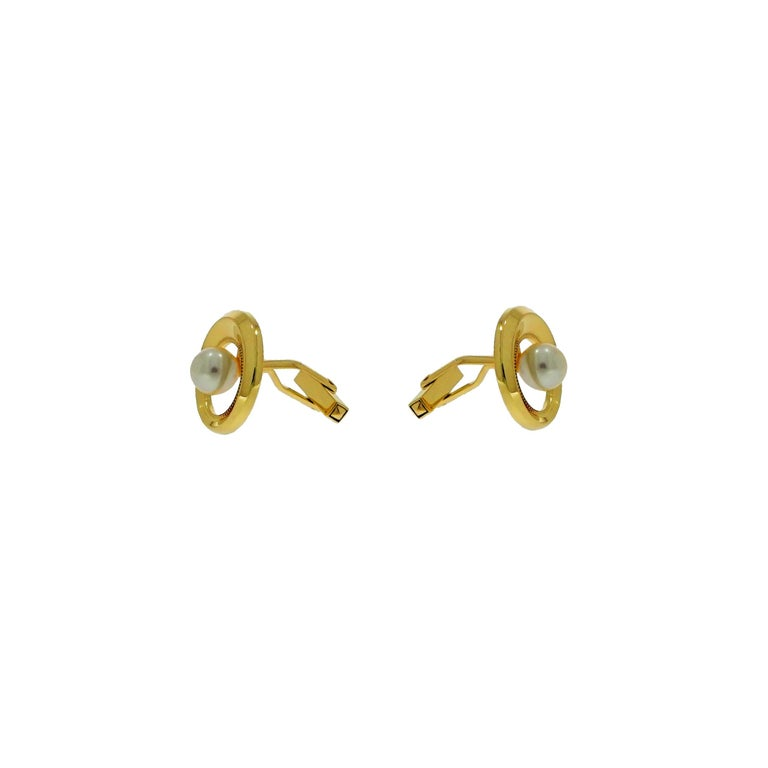 Gorgeous set of Akoya Pearl cufflinks is crafted in 14k Yellow Gold. Open circle design with a White Akoya pearl center, the outer smooth beveled framed is high polished with millgrain edged in the interior side. Measures approximately 21mm in