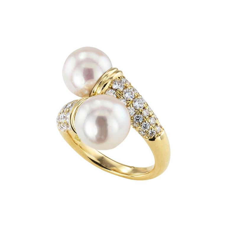 Cultured pearl diamond and yellow gold bypass ring circa 1990.  Clear and concise information you want to know is listed below.  Contact us right away if you have additional questions.  We are here to connect you with beautiful and affordable