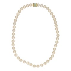 Cultured Pearl Row with Diamond and Emerald Clasp