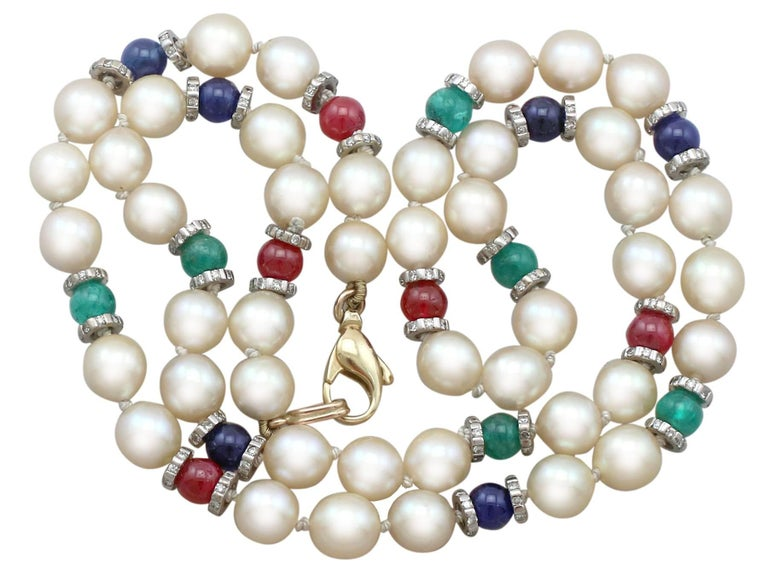 An impressive cultured pearl, 1.66 Ct diamond, 8.20 Ct sapphire, 7.38 Ct emerald, 7.25 Ct ruby and 14k gold necklace; part of our diverse gemstone jewelry collections.  This fine and impressive pearl necklace is composed of forty-four individually