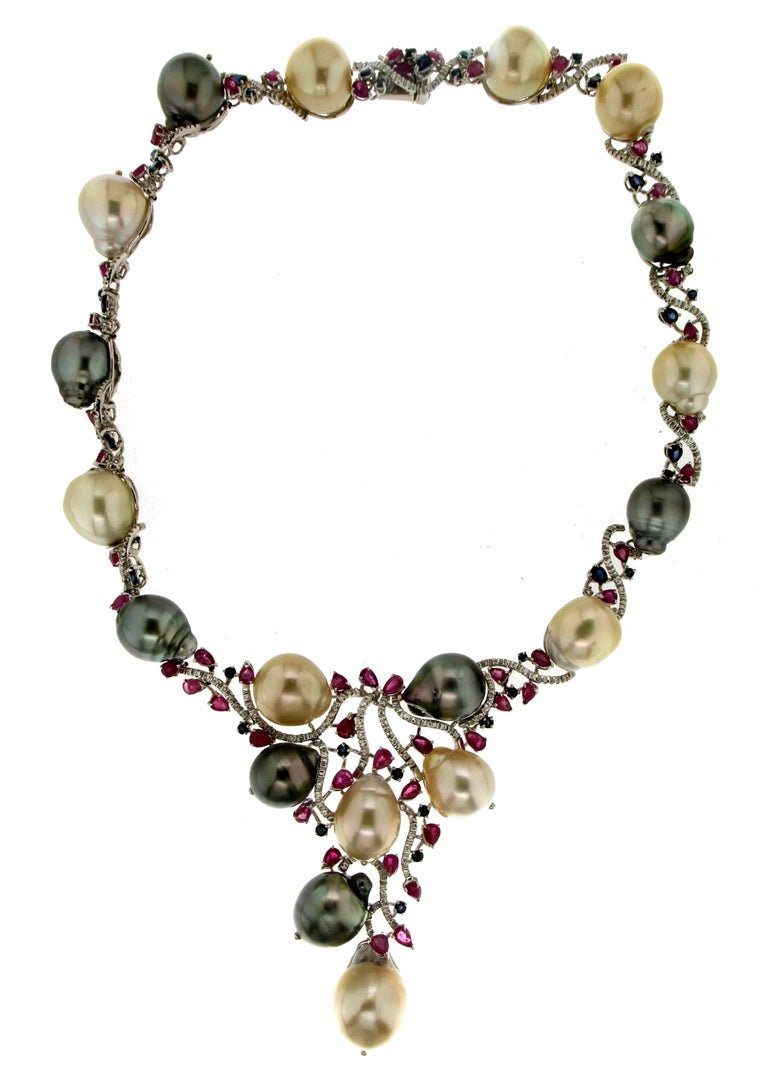 Tahiti and Australian cultured pearls white gold 18 carat mounted with diamonds rubies and sapphires choker necklace  Necklace total weight 123.20 grams  Diamonds weight 1.46 carat Rubies and sapphires weight 12 carat Pearls weight 350 carat