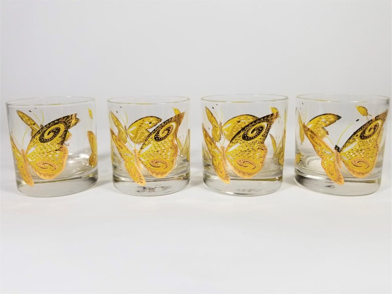 Midcentury glasses with butterfly motif by Culver Inc. 22-karat gold textured design. Gorgeous for bar or table. All glasses are signed. Set of 4. Excellent condition.