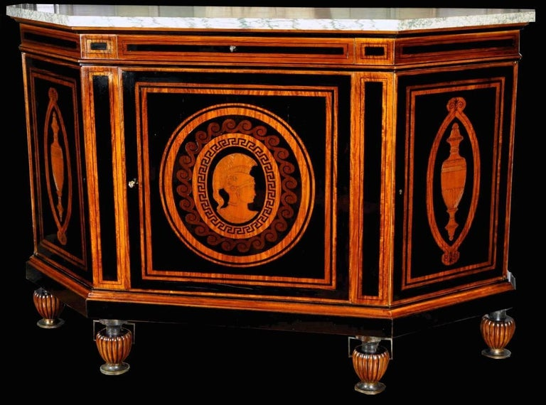 A curious French early 20th century sideboard signed E. Duru with three doors. White and green veined marble-top. Neo Greek vase form feet. Signed in centre of the front door. Measures: 114 x 149 x 48 cm.