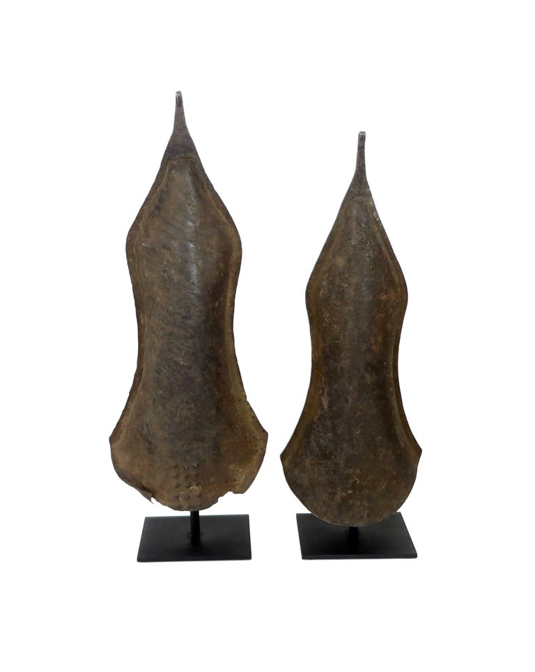 Iron currencies were shaped by blacksmiths of the Nkutshu people of the greater Congo Region. Forged of iron, and used for ceremonial events, and major but infrequent transactions. Though no longer used, this sculpted shaping of functional forms