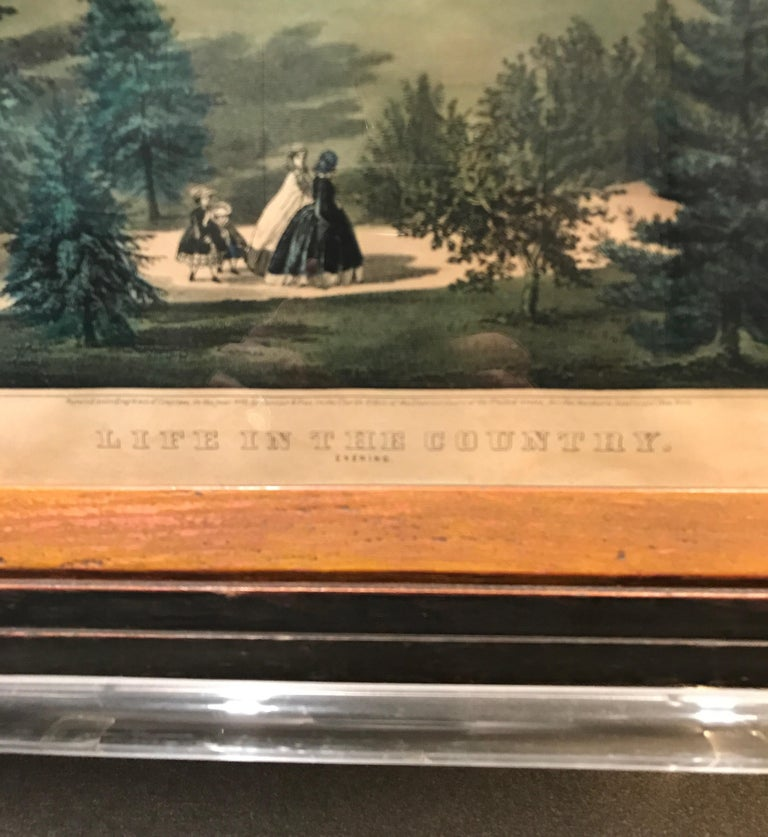 Hand colored lithograph by Currier and Ives 'Life In The Country Evening' entered according to an Act of Congress 1860. Signed E F Palmel Del.  The print is framed in an elegant old oak frame with old glass. Could be original.  Print W 15.5, H