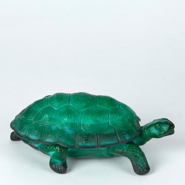 A stunning and rare Art Deco Bohemian Curt Schlevogt malachite green glass tortoise container moulded as a standing tortoise with a lift off fitted shell dating from circa 1930. The tortoise is well detailed with matted textures and is not marked.