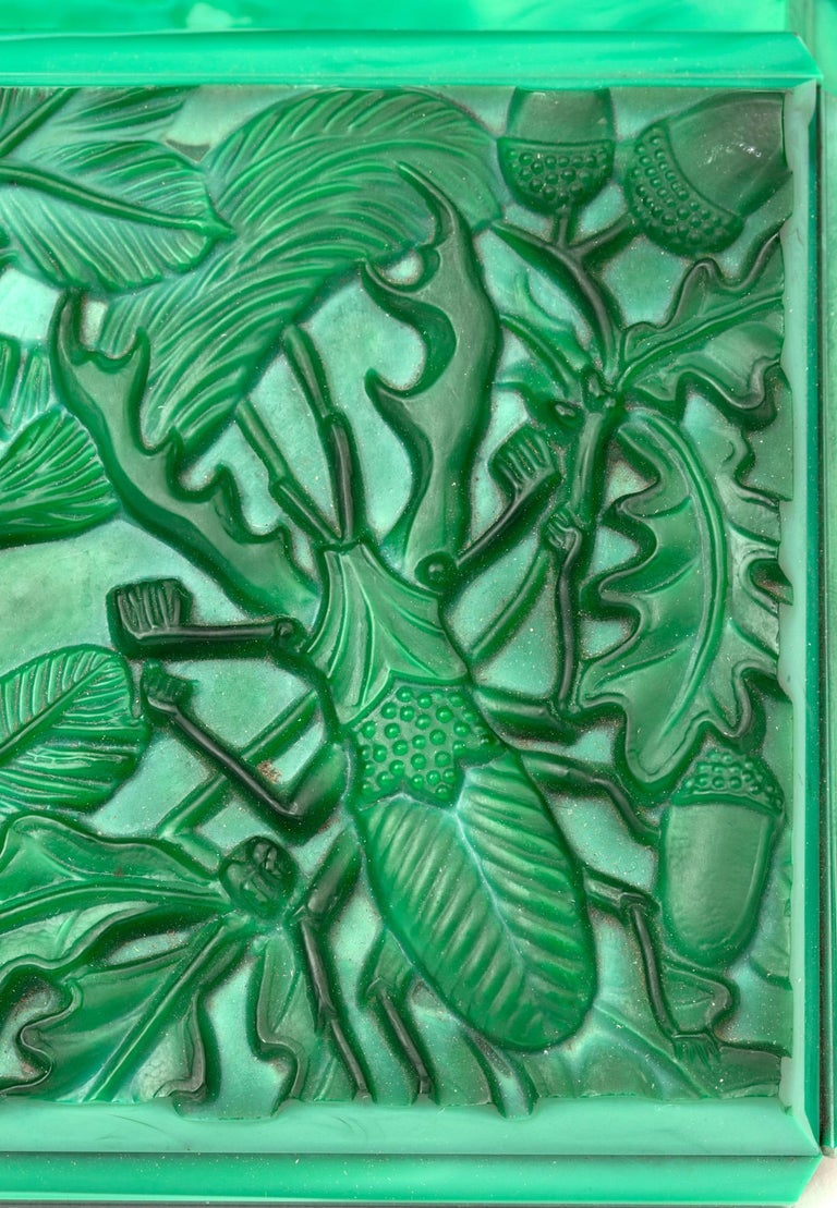 A stunning Art Deco Czech malachite green glass lidded box by Curt Schlevogt dating from circa 1930. The rectangular shaped box has panel cut sides with a hinged cover moulded in deep relief with a squirrel perched on a branch and gathering nuts and