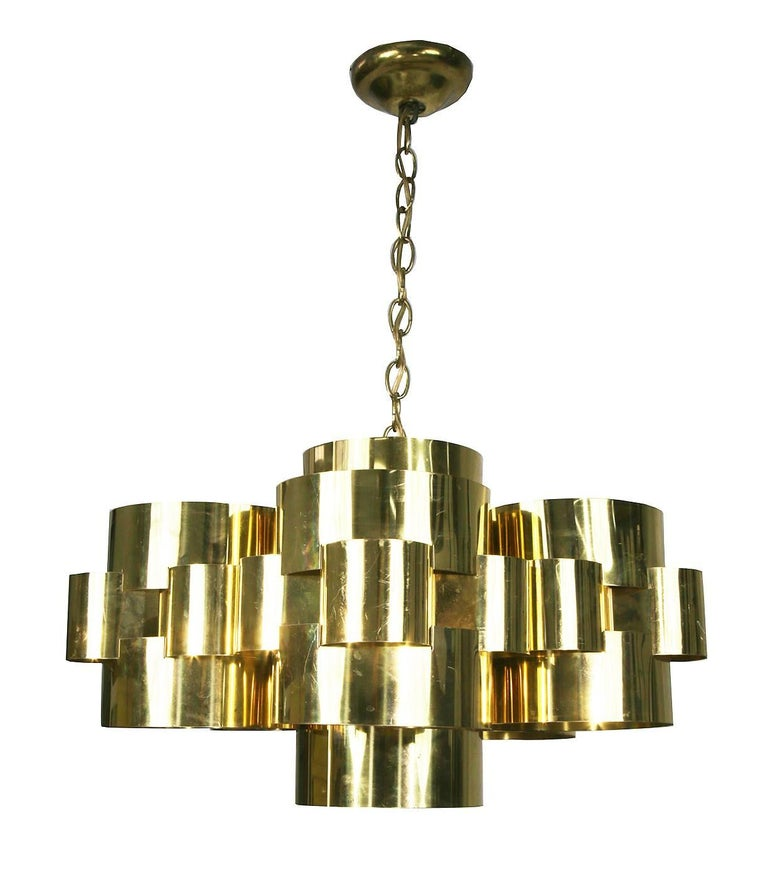 Signed Curtis Jere chandelier comprised of circular polished brass sheets grouped together to make a heavenly cloud formation.