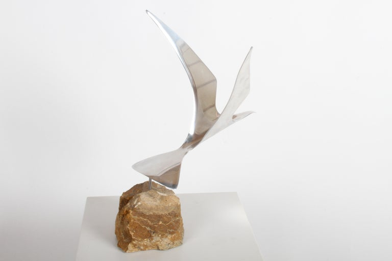 Curtis Jere aluminum flying seagull table sculpture on quartz rock base, signed on lower right tail C. Jere, 1980. Signature is scratched into aluminum, hard to photograph. Very nice original condition.