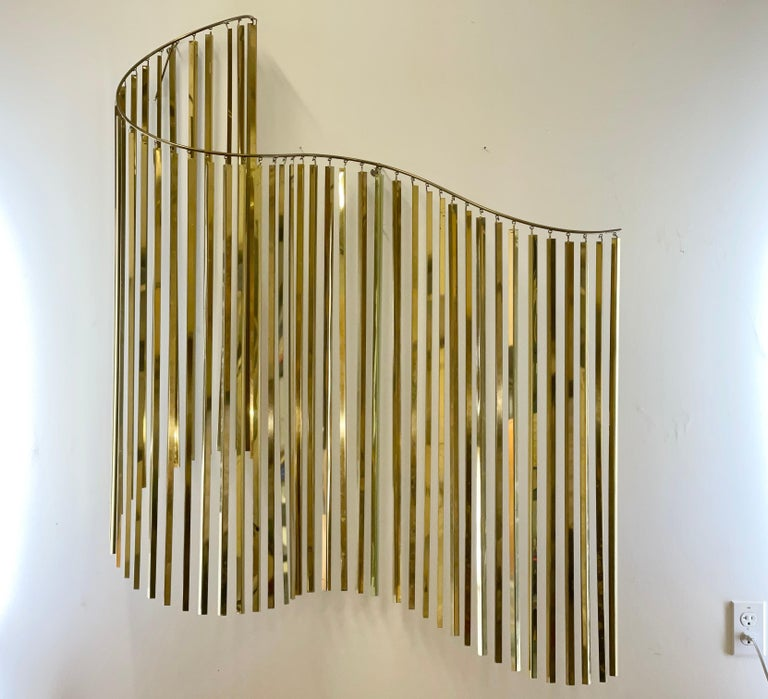 Dazzling kinetic grand scale wall sculpture designed by Curtis Jere and produced by Artisan House in the 1980s. Signed and dated 1983 ~42 inches wide by ~52 inches high. This must have been incredibly expensive to produce as each of the ~50 rods