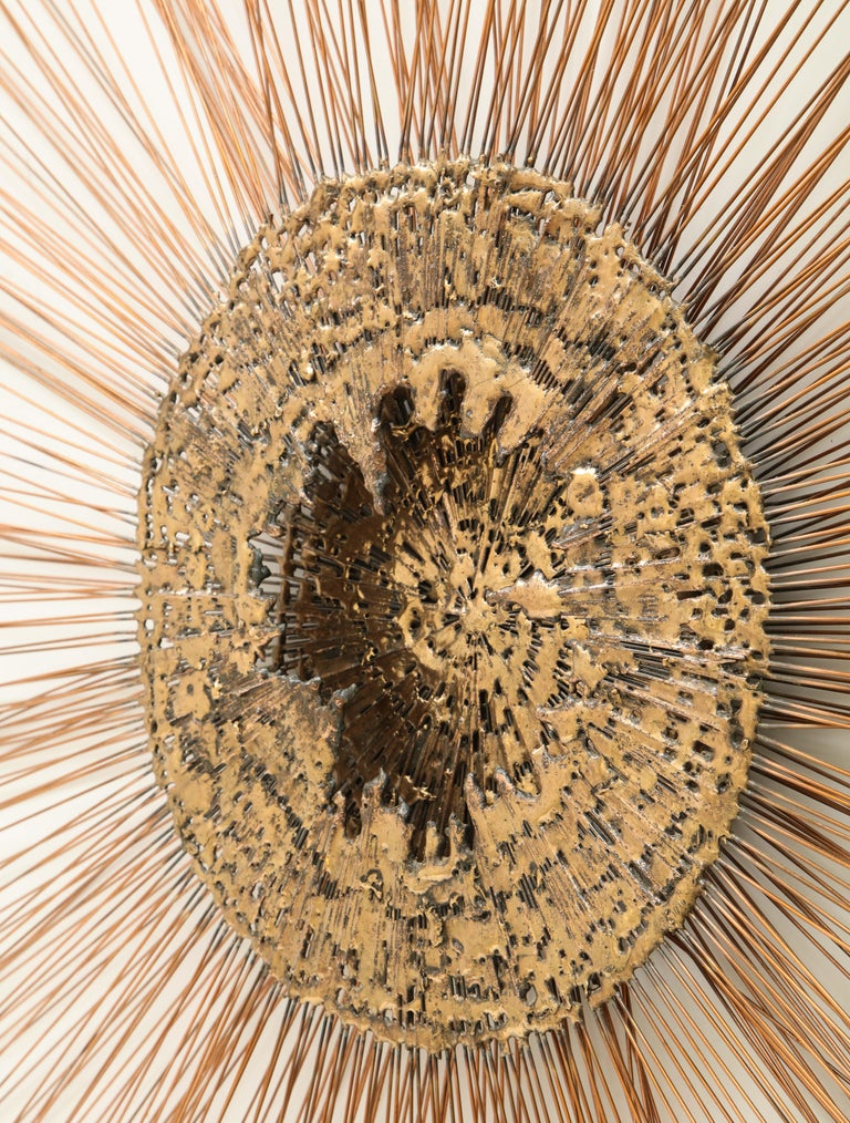 Brass wall sculpture by Curtis Jere, featuring a golden molten center design with radiating twisted brass rods.