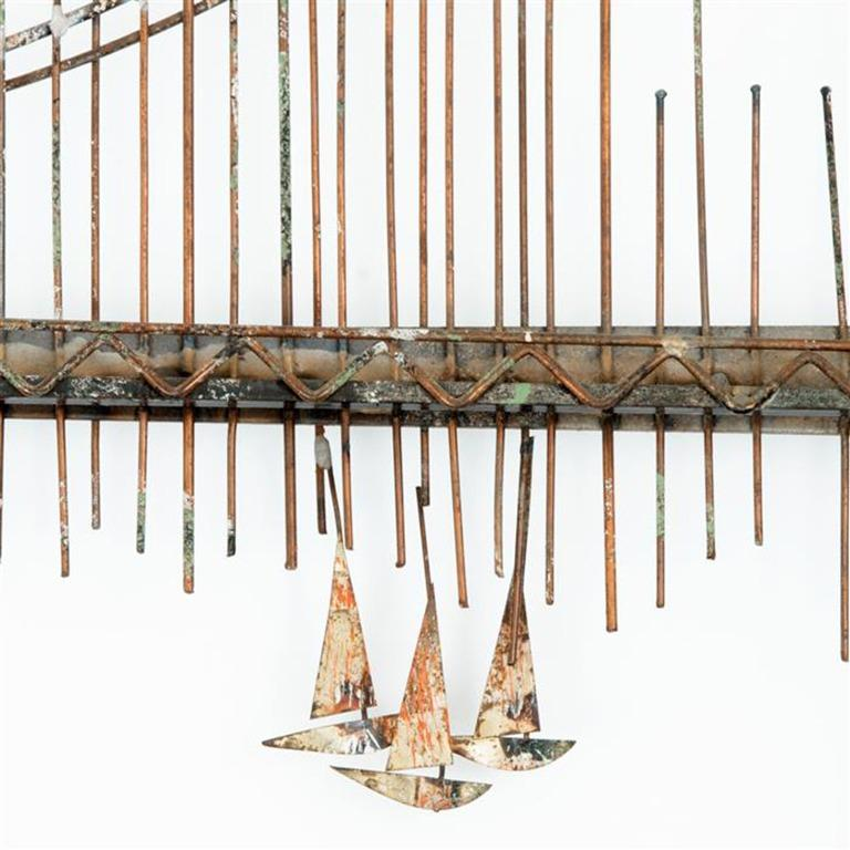 Brutalist style golden gate gilt steel wall sculpture by American brand Curtis Jere. The sculpture still features the original sailboats on the bottom right.