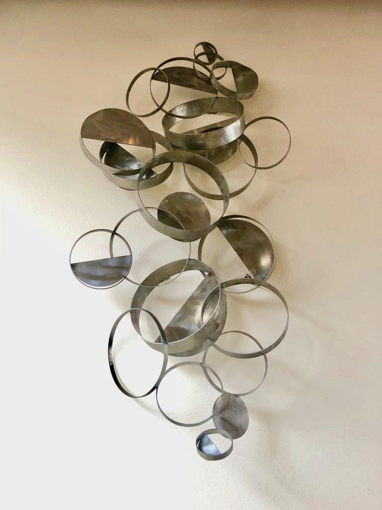 Curtis Jere floating ring sculpture. Signed C. Jere 1988.