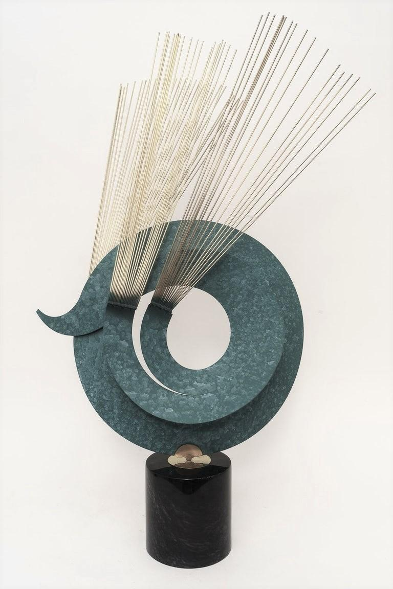 Kinetic sculpture in Verdi Gris coloration, marble and brass by Curtis Jere Artisan House, 1996  Overall size is 23 wide by 15 deep and 37