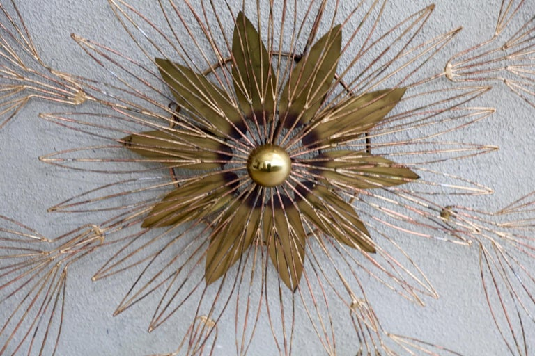 A nice signed Curtis Jere wire wall sculpture in the shape of a star blossom. it is signed and dated 1980. This piece appears to have clearly been touched up, but it is an unusual one and large at almost 4 feet in diameter.