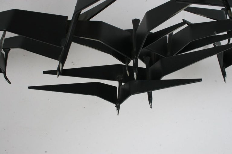 Black painted metal with silver highlights, sculpture of birds in flight, signed and dated 1969. Nice original conditions, light touch up to one wing.