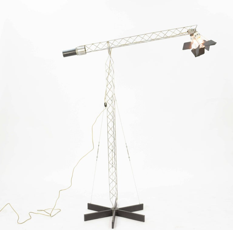 'Crane' floor lamp by Curtis Jere, 1977. The metal craft work in this playful lamp is stunning! The moving flaps around each bulb, to the finely constructed crane-like stem and arm, to the taught wires holding it to the base, this lamp is a marvel