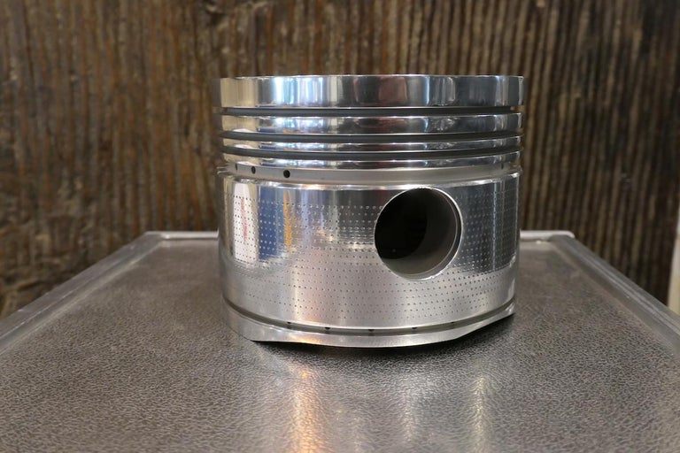 An authentic piston from a Curtiss-Wright R-1820 Cyclone aluminum engine that was mounted on the McDonnell Douglas Aircraft DC-3 also called Dakota. Mythical plane of the 1940s-1950s. Ventilated technical part, an example of the technical nature of