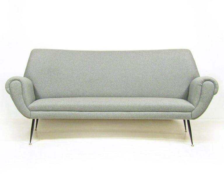A gracefully curved 1960s Italian sofa by Gigi Radice.