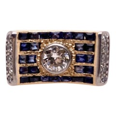 Curved Gold Diamond and Sapphire Ring