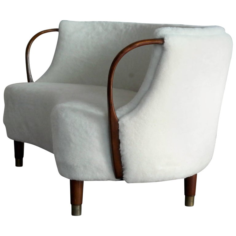 Unique and just superb curved or banana shaped loveseat or settee with open armrests designed and made as Model 96 by N.A. Jørgensens Møbelfabrik in 1954-1955. N.A. Jørgensen is better known under the name Bramin Mobler a name they adopted in the