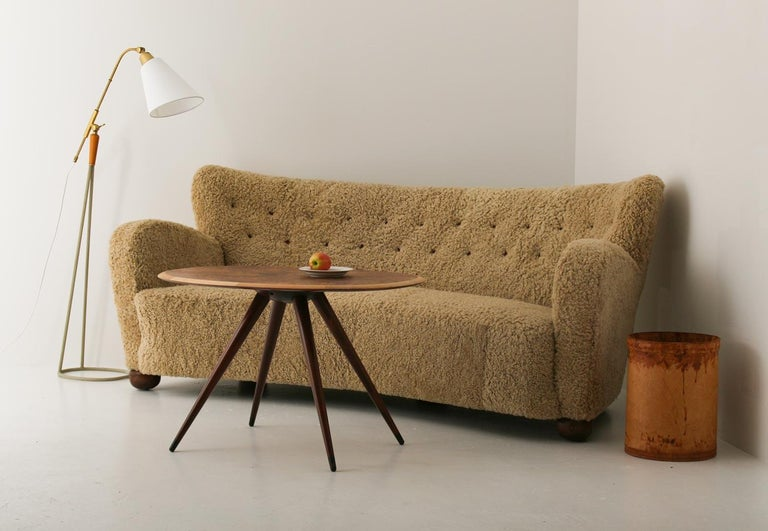 Stunning Swedish 3 or 4-seater sofa by unknown manufacturer. This organically shaped sofa is constructed with a very high sense of quality. The round feet match the soft curves and the overall proportions give a harmonic impression.  Condition: