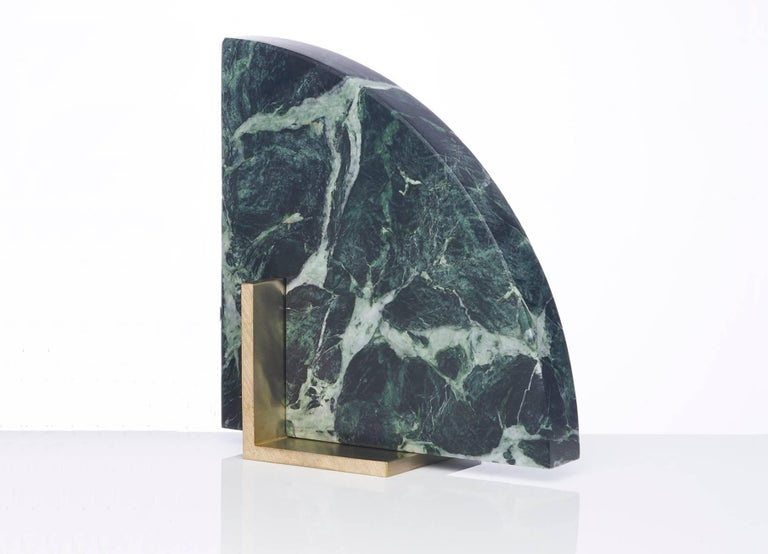Meet Curvy; one half of the odd couple bookends set which are now available to buy individually. You can now mix and match colors and shapes. Curvy is available in Verde marble and a brushed brass base. The marble is cut into a geometric shape,
