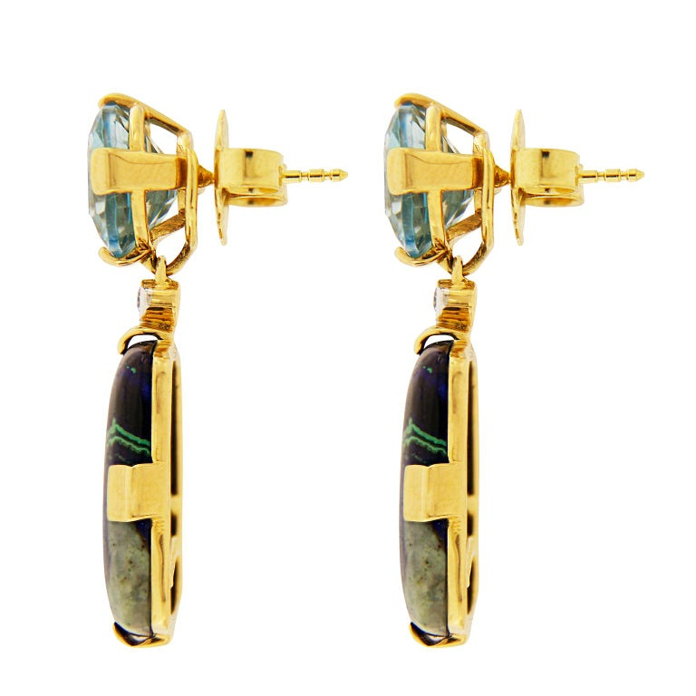 These lovely earrings feature blue cushion Topaz and trapezoid Azurite Malachite with rectangle pave motif in 18kt yellow gold. They are finished with clip-backs (post can be added upon request).