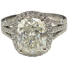 Cushion Cut 4.09 Carat Diamond in Triple-Row Split Shank and Halo Setting