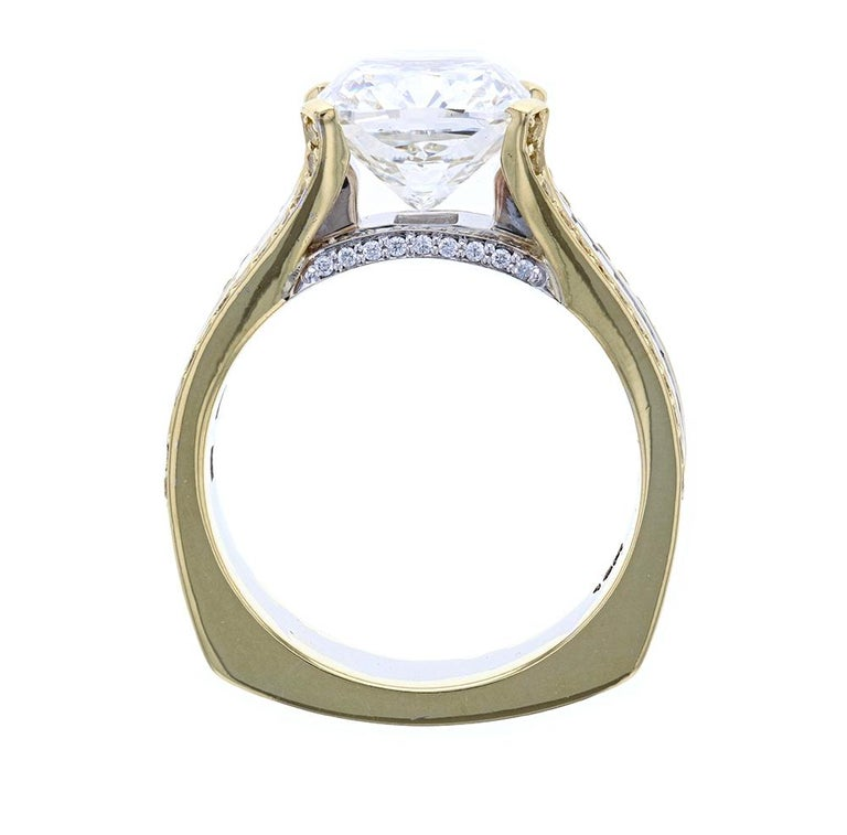 This custom ring is crafted in 18k 2-tone Gold and contains a 4 Carat Cushion Cut center diamond surrounded by 40 Baguette Cut Diamonds, 52 Round Fancy Yellow Diamonds and 32 Round Brilliant Cut Diamonds with a band width of 7.2 mm and a European