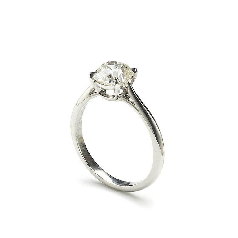 A diamond solitaire ring, set with a 1.64ct, K colour, VS1 clarity, cushion old-cut diamond, in a four claw setting, mounted in platinum, with tapered shoulders, made in our London workshop, accompanied by AnchorCert certificate 20012914.  Finger