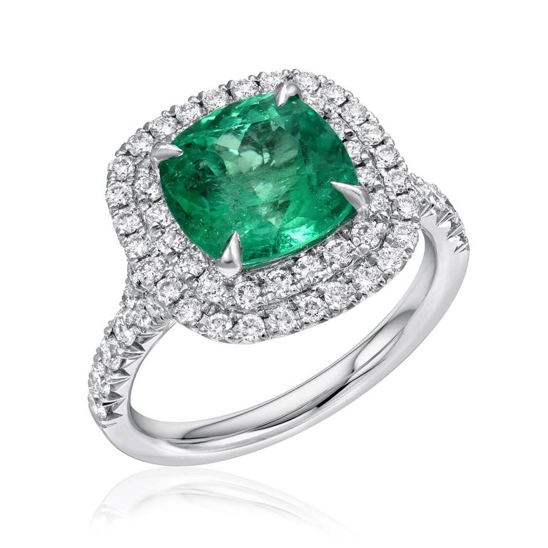 Colombian Emerald ring featuring a 2.82 carat cushion cut Emerald, surrounded by round brilliant micro pave diamonds weighing a total of 0.79 carats, in an 18K white gold engagement ring. Ring size 6.5. Re-sizing is complimentary upon