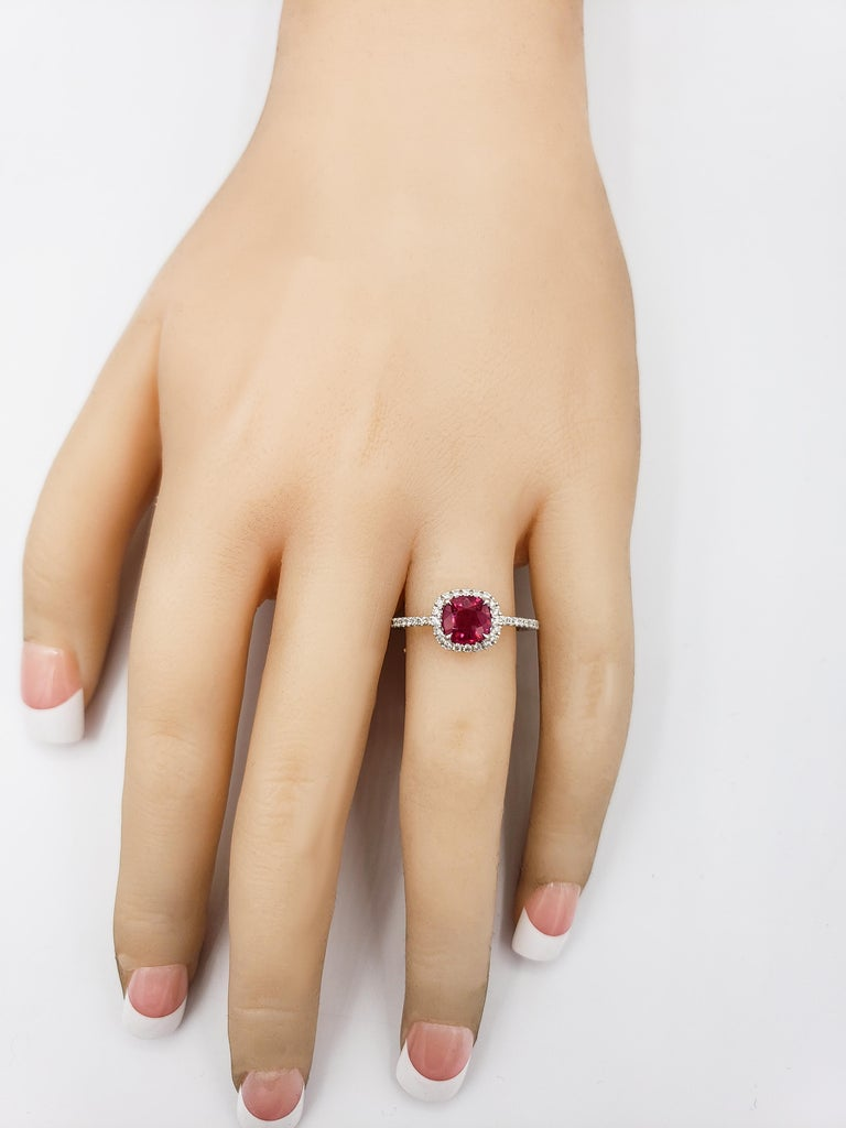 Contemporary Cushion Cut Ruby and Diamond Halo Engagement Ring For Sale