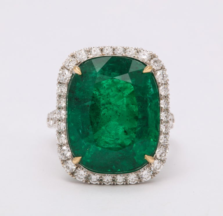 VIVID GREEN EMERALD!  14.92 carat cushion cut vivid green emerald set in a custom made platinum and diamond mounting.   1.33 carats of white round brilliant cut diamonds.  Certified by Christian Dunaigre of Switzerland.  A fabulous emerald ring in