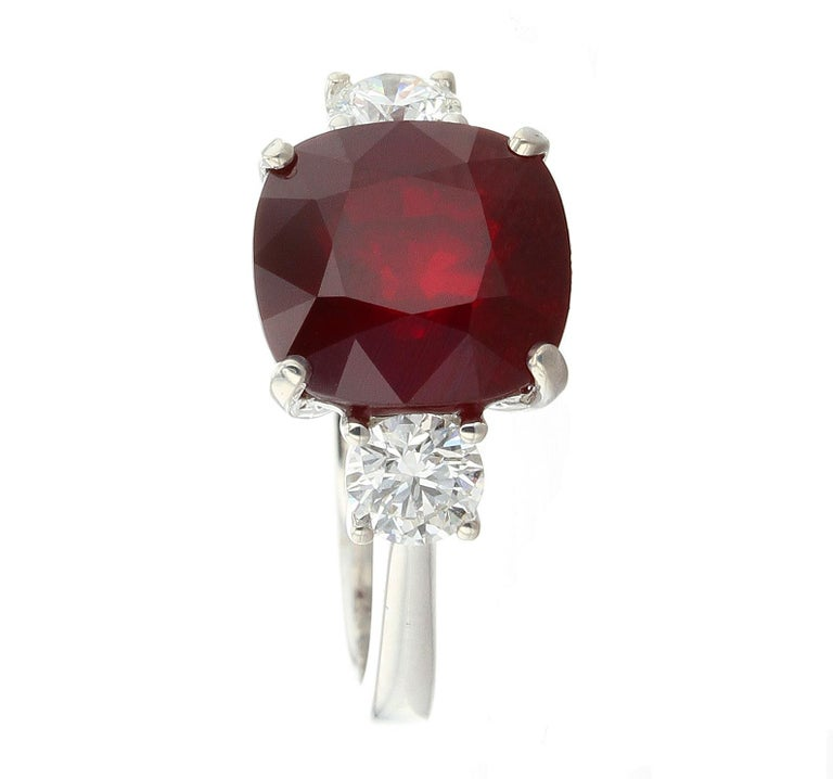 A stunning and clean cushion cut Mozambique Ruby weighing a little over than 6.50 carats, accented with two round diamonds mounted in 18K White Gold. AGL and GIA Certificates available.