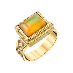 Cushion Opal Cabochon and Diamond Yellow Gold Engraved Bezel Dome Band Ring