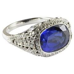 Cushion Sapphire 8.64 Carat and Diamond Platinum Ring
