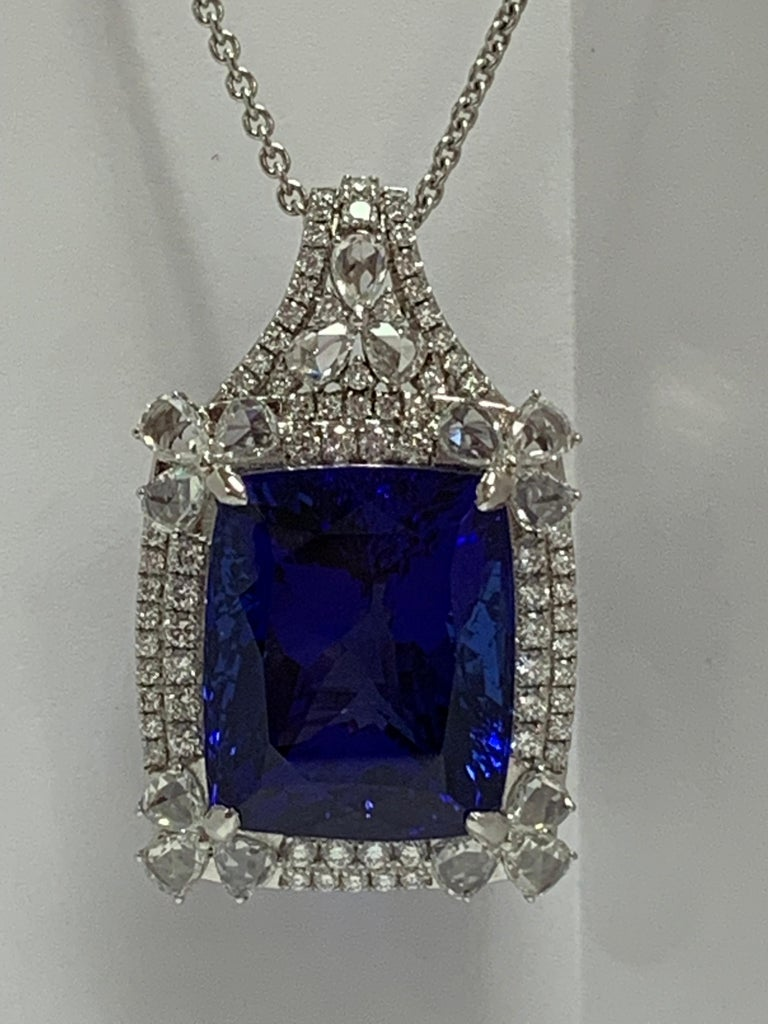 Natural Cushion shape Tanzanite and 2.99 Carat of white Diamonds set in 18 Karat white gold is one of a kind handcrafted pendant. The Pendant include 18 Karat 18 Inches white gold chain .
