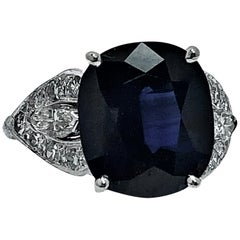 Cushion Shaped Dark Blue Sapphire and Diamond Ring Set in Platinum