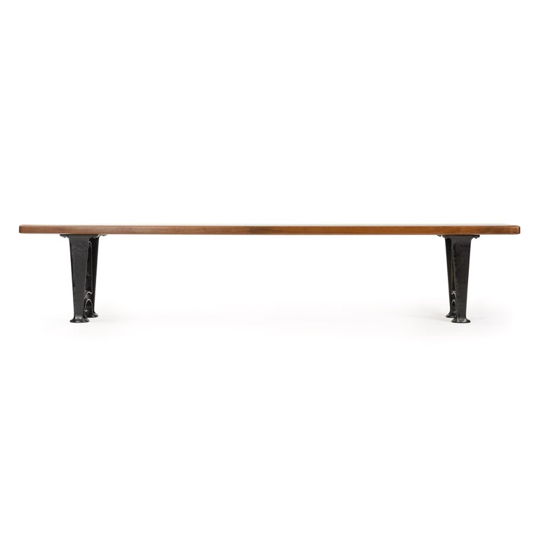 A bench with a solid walnut top on patinated cast iron legs. Custom made by the Wyeth Workshop in NY. Also available in custom lengths, woods and finished.