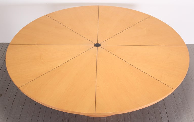 Custom made Biedermeier style large round pedestal table made by Continental Furniture Company. This gorgeous table is made of maple with an ebony wood inlay and a scalloped base. Minor imperfection to wood as shown in images. Top is removable for