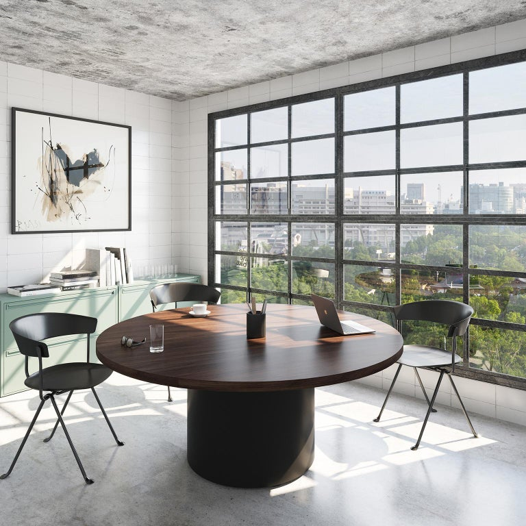 The Column table is a modern round meeting table that proves there's beauty in simplicity.  Its clean geometric lines happen to be highly functional, providing more legroom (and seats) around the pedestal base and allowing the table to fit into