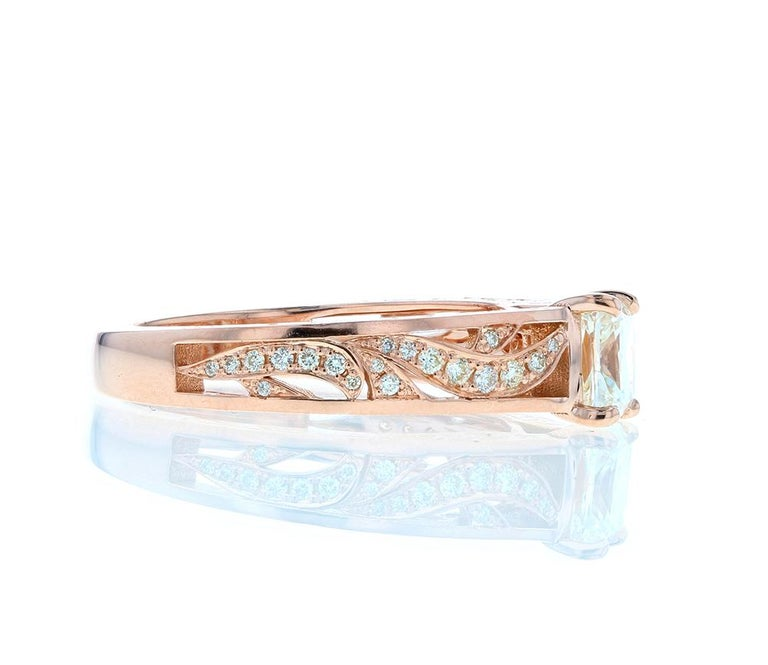 A beautiful Custom Cushion Cut Diamond Engagement Ring with Rose Gold Botanical Engraving features an over 1 carat diamond center with custom engraving and diamond pave on the shank. An elevated setting creates and elegant profile and unique design