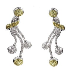 Custom Designed Pair of 18 Karat White Gold Ear Clips with Yellow Gold Prongs
