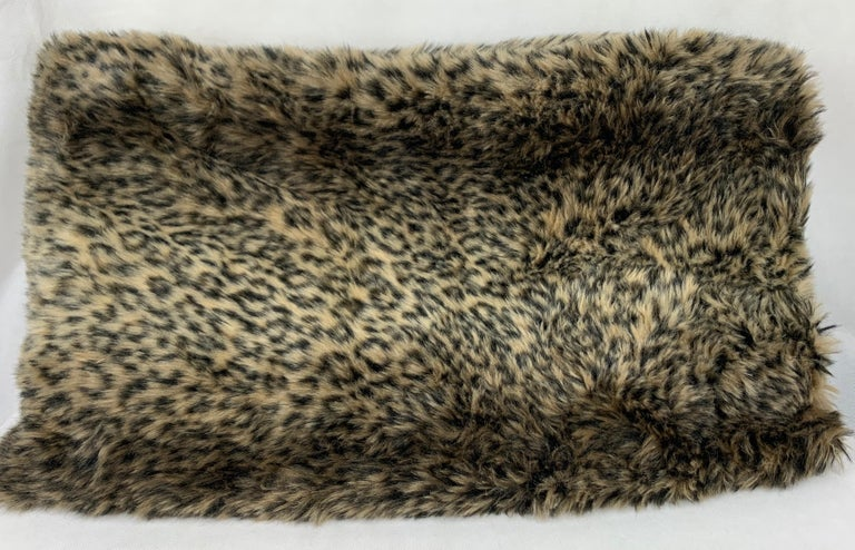 Luxurious faux leopard throw made by a talented seamstress for our shop. Trimmed with a soutache style of passementerie and lined with black velvet. Dry clean. Measures: 52