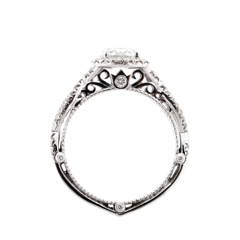 This stunning diamond wedding set features a criss crossed diamond shank, a raised profile and peekaboo diamonds on either side.  The matching wedding band emulates the shank and features a surprising level of detail.    Please note that each piece