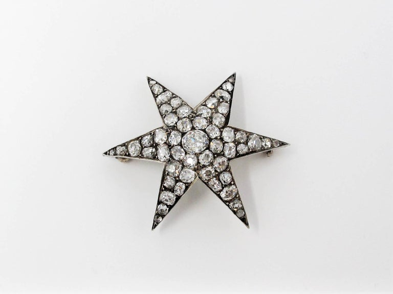This extraordinary custom one of a kind diamond star brooch will be a lovely addition to your fine jewelry collection. This is a timeless brooch with exquisite fine details from the Victorian Era.   The brooch is made of 14 karat yellow gold clad