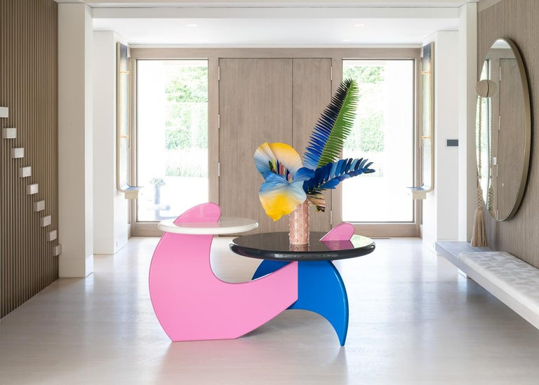 Tiered entry table   High gloss lacquer table comprised of two table heights and 4 distinct colors.